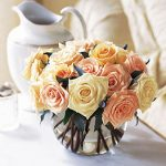 Roses arranged in a short vase 55.00
